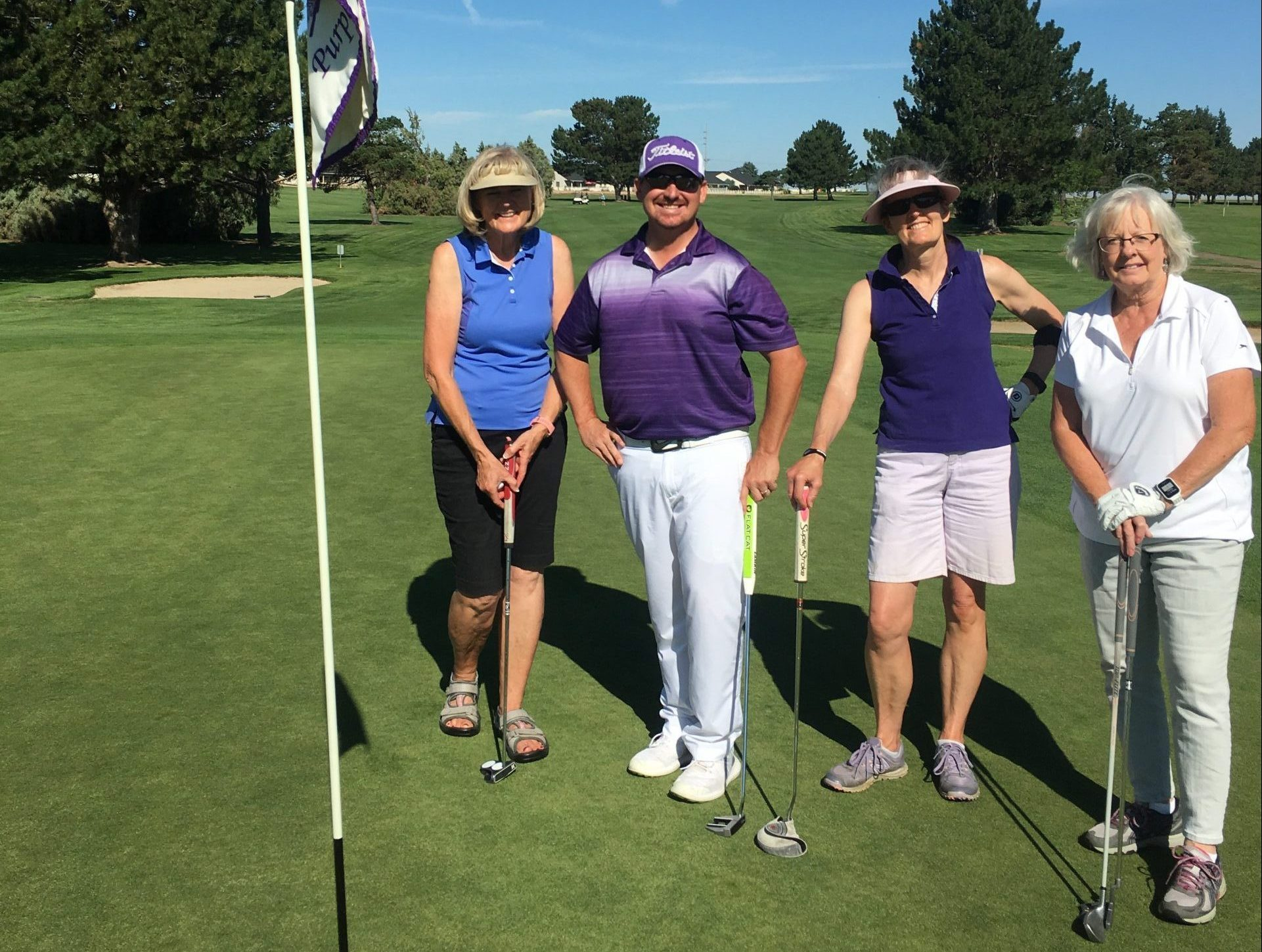 Coach Pete golfing with the ladies